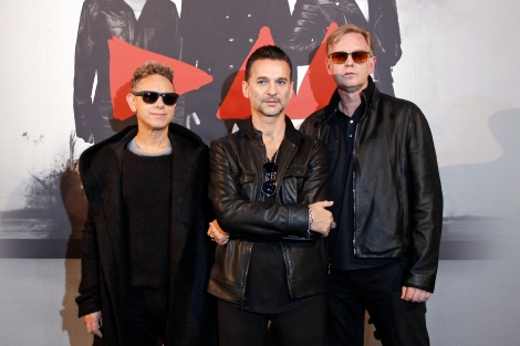 From L-R, Martin Gore, Dave Gahan and Andrew Fletcher of British band Depeche Mode pose during a photocall before a press conference in Paris